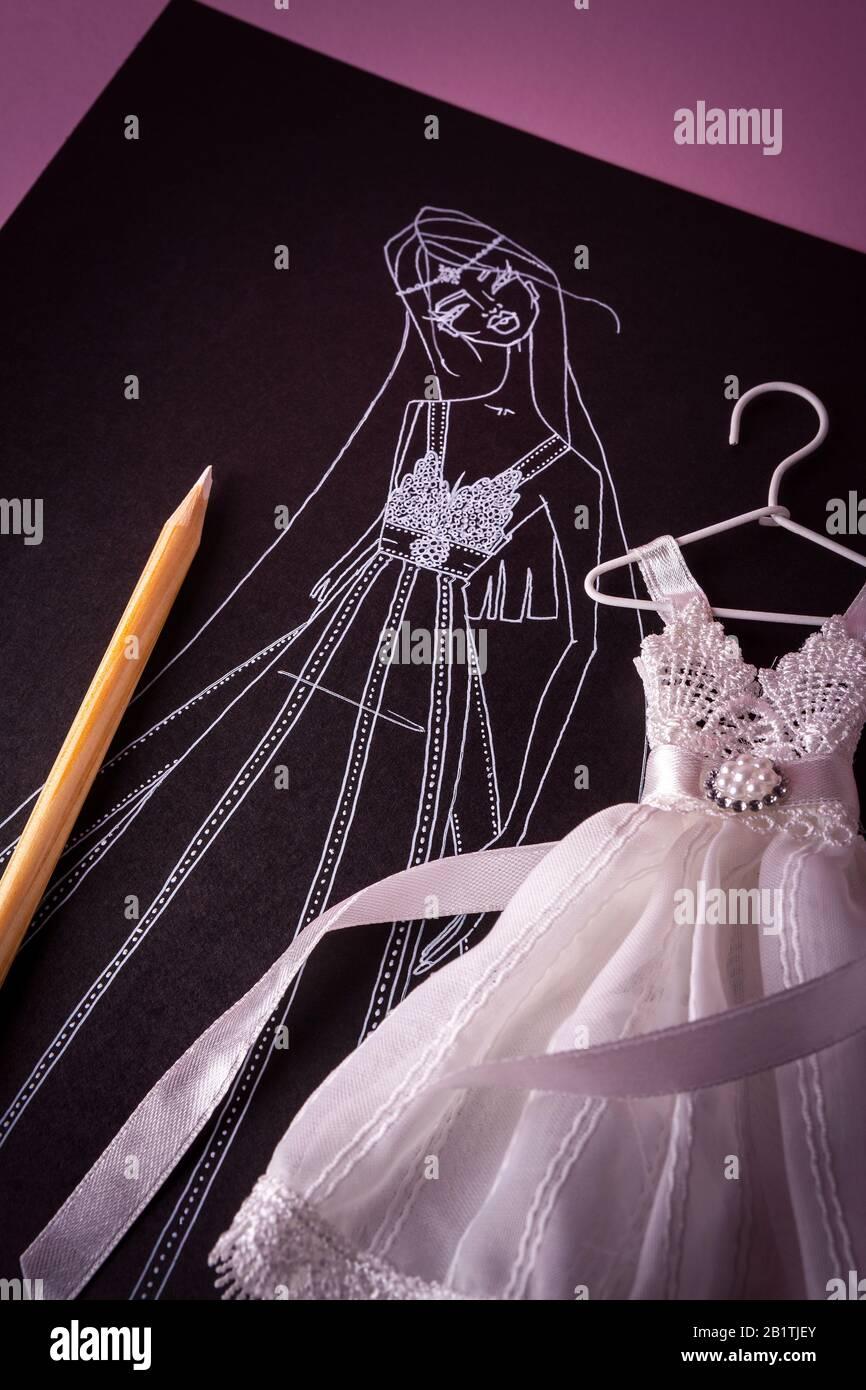 Sketch For Wedding Dress With Miniature Model Stock Photo Alamy