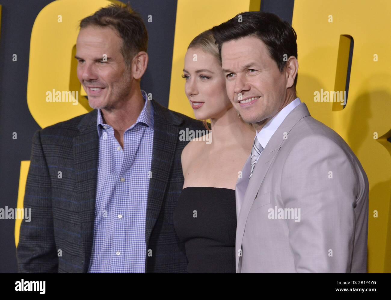 Los Angeles Usa 27th Feb 2020 L R Director Peter Berg Iliza Shlesinger And Mark Wahlberg At The Netflix S Spenser Confidential Premiere Held At The Regency Village Theatre In Westwood Ca On Thursday