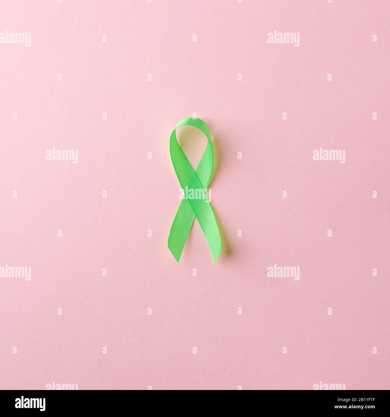 Green Satin Ribbon On Pink Background Liver Kidney Cancer Awareness Glaucoma Awareness Stock Photo Alamy