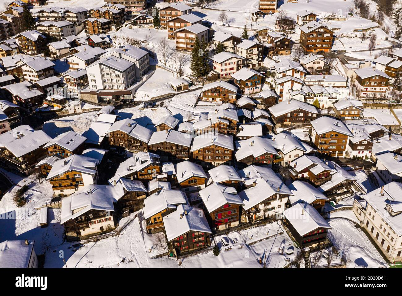Aerial view of the snow covered Leukerbad village in the Swiss alps in Canton Valais in Switzerland Stock Photo
