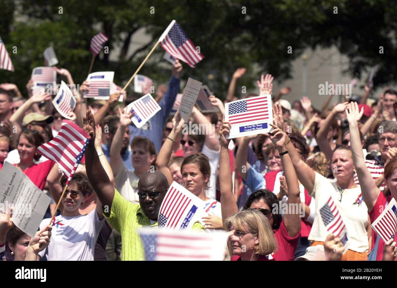 "Crowd waving American flags and flag posters at ""support the troops"" rally  in small Texas town of Belton during first Gulf War in 1990. Stock Photo"
