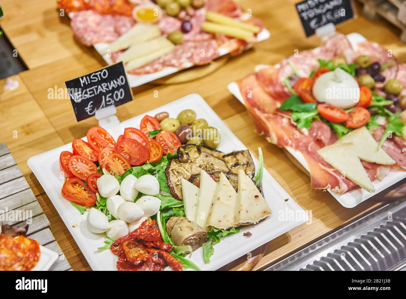 Vegan Menu Light Italian Snacks Cheese Plate With Tomatoes And Olives Delicious Cheese Mix On Wooden Plate Street Food Market In Florence Italy Stock Photo Alamy