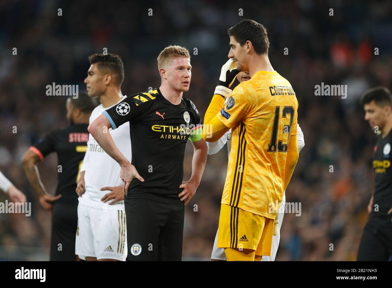 Madrid, Spain. 26th Feb, 2020. (L-R) Kevin De Bruyne (ManC), Thibaut Courtois (Real) Football/Soccer : UEFA Champions League Round of 16 1st leg match between Real Madrid CF 1-2 Manchester City FC at the Santiago Bernabeu Stadium in Madrid, Spain . Credit: Mutsu Kawamori/AFLO/Alamy Live News Stock Photo