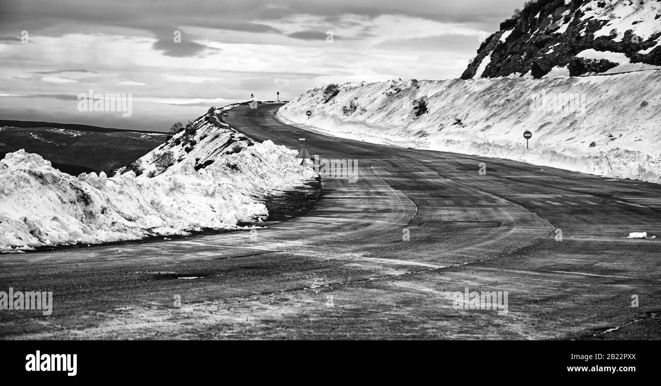 Ice and snow on the road, December and danger, travel Stock Photo