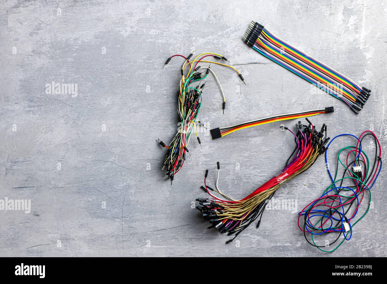 Electrician Electronics Different Wires On A Gray Wooden Background Place For Text Top View Copy Space Stock Photo Alamy