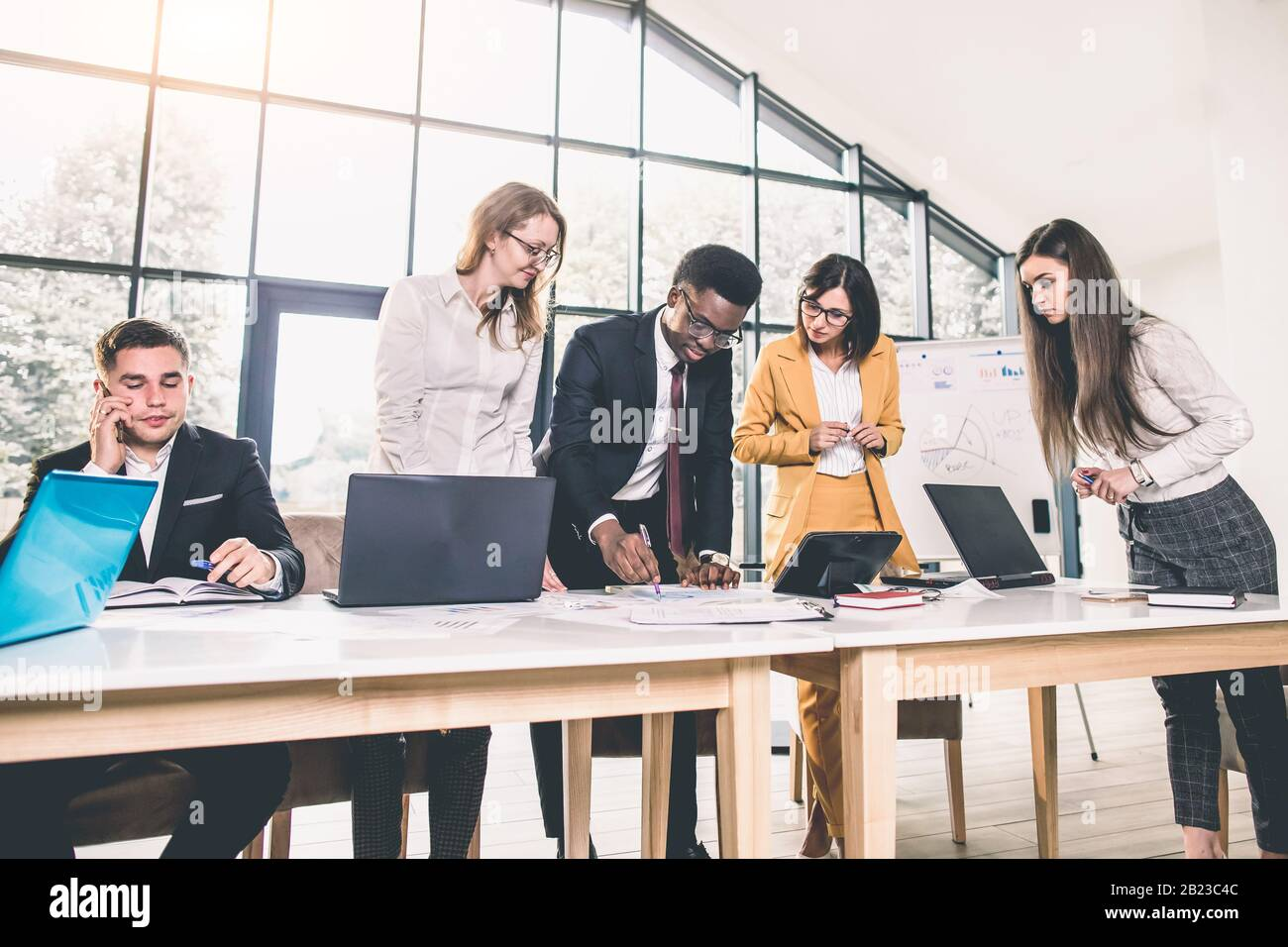 Picture of young architects discussing in office Stock Photo