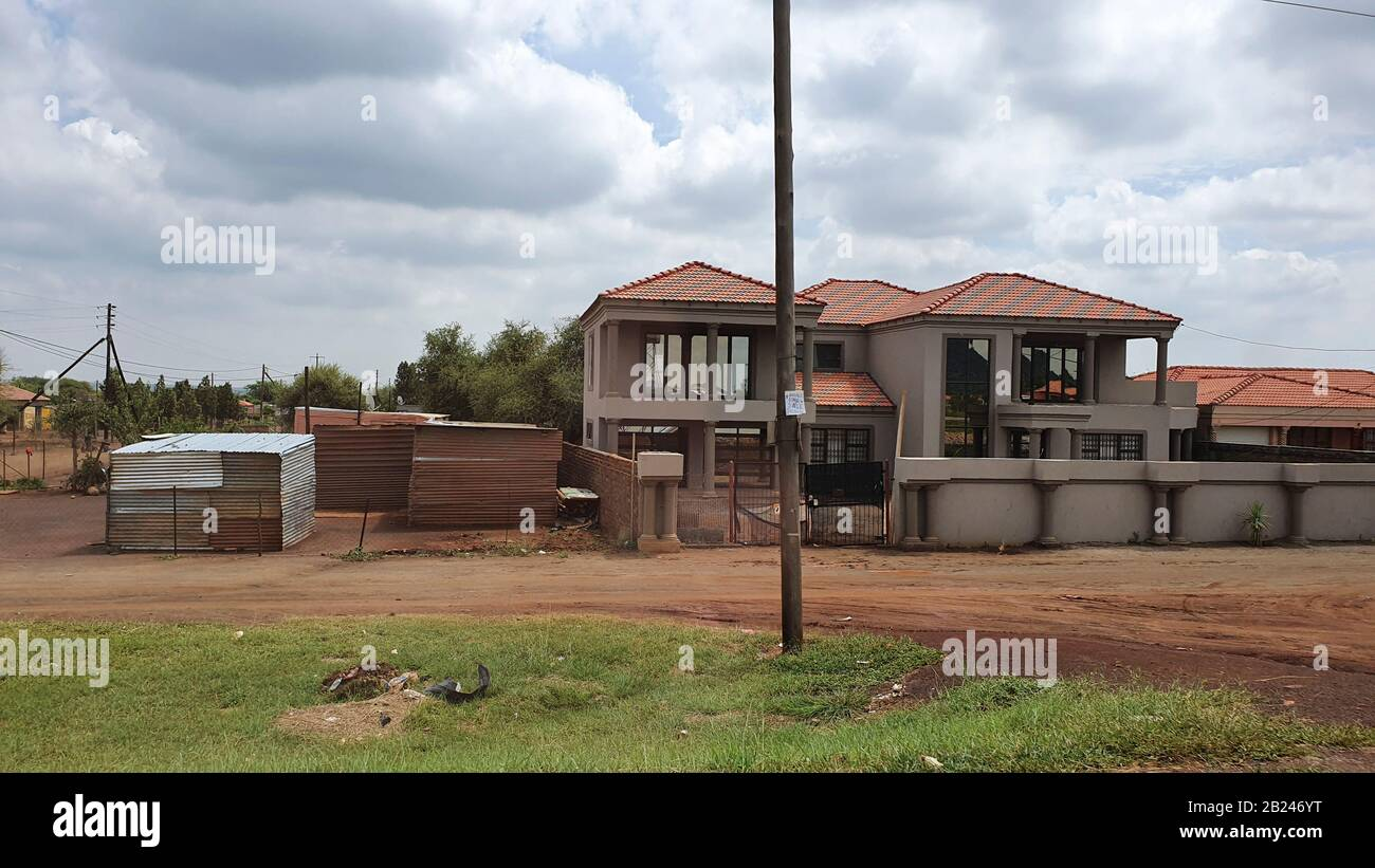 Lekgalonng, South Africa - 23 feb 2020: South African village with various houses both large and small, Here rich and poor live together Stock Photo