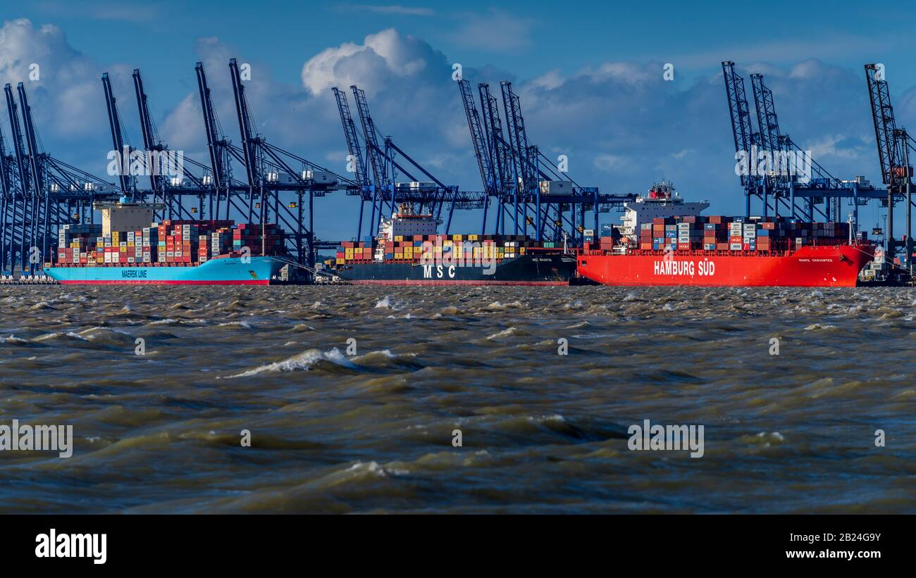 AP Moller Maersk Group Ships - Maersk Line, MSC & Hamburg Sud Containers Ships moored at Felixstowe Port in the UK during a storm. Any Port in a storm Stock Photo