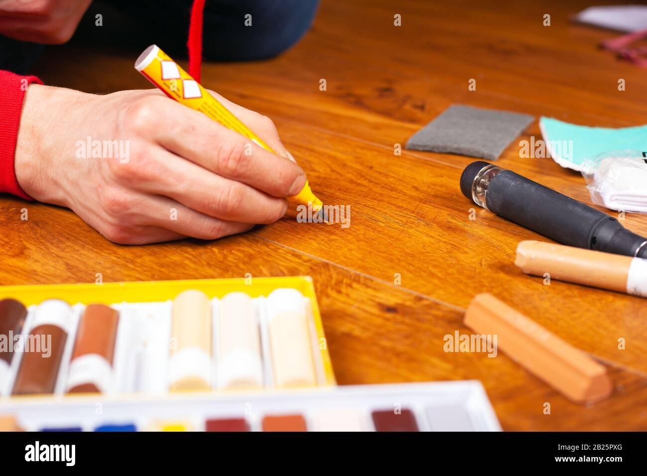 Repair Restoration Laminate Flooring Parquet And Wood Products Sealing Scratches And Chips Master Processes The Surface With A Special Pencil To Remo Stock Photo Alamy