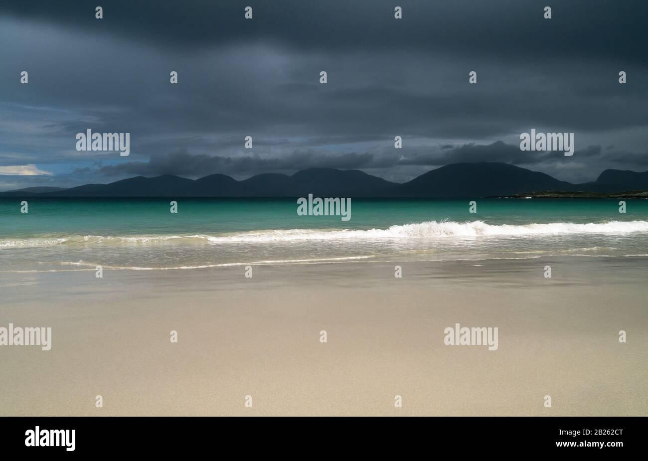 Dark cloudy skies over the smooth sands of Luskentyre Beach (Traigh Rosamol), Isle of Harris, Scotland, UK Stock Photo