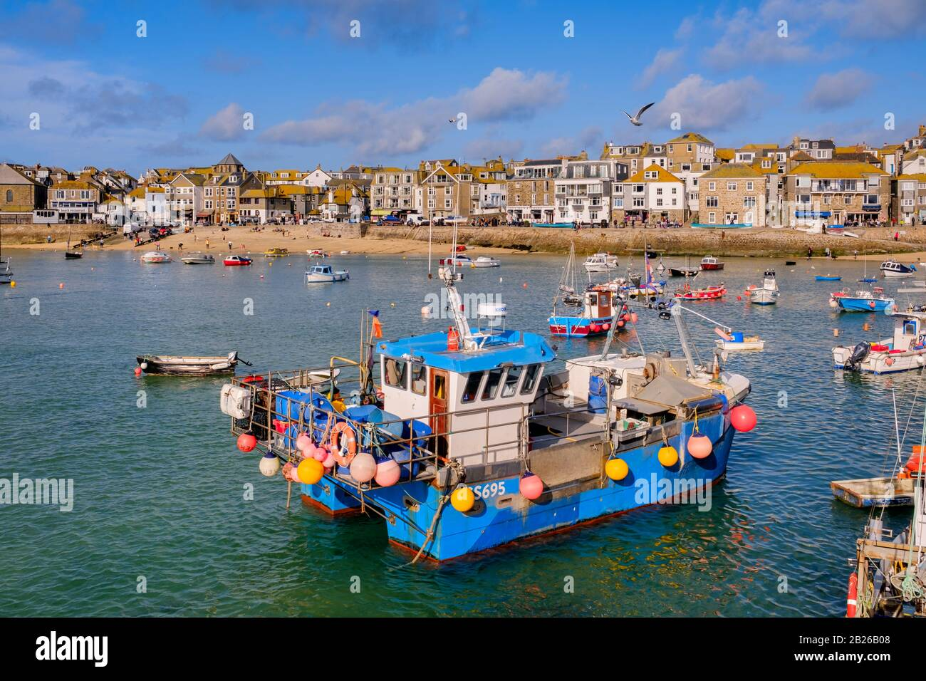 Views across St Ives Harbour to St Ives village and Smeatons Pier with boats in the Harbour, Cornwall, South West, UK Stock Photo