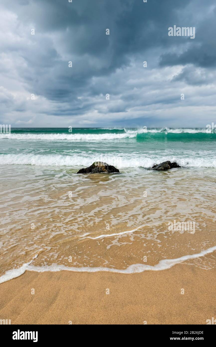 Porthmeor beach St Ives, Cornwall, surfing beach, artistic Cornwall, Cornwall colours, sea, sand, rocks, surfing, holiday destination, Uk travel, Stock Photo