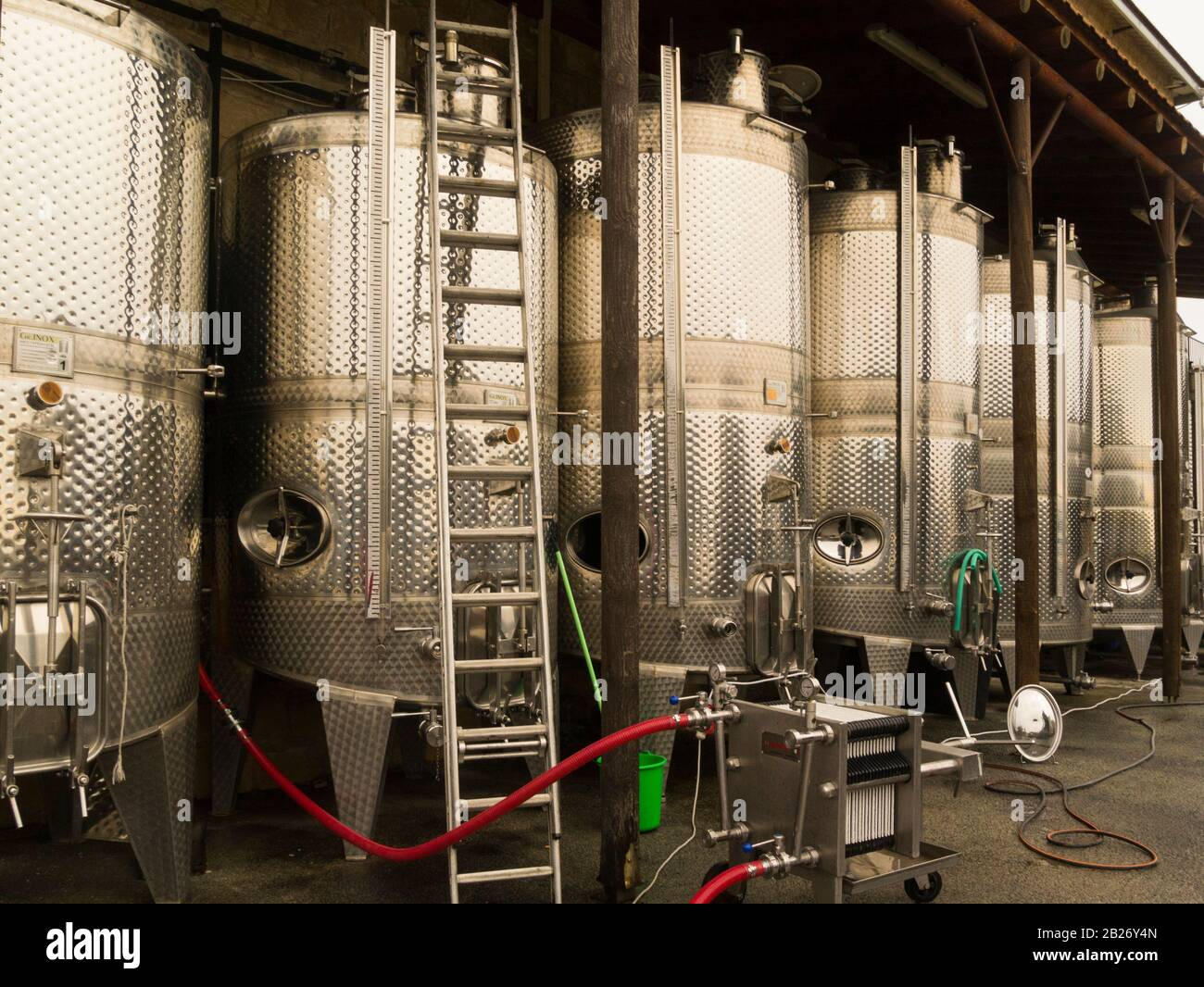 Stainless steel vats containing fermenting wine in Ktima Gerolemo winery Omodos Cyprus producer of award winning red white rose and sweet white and re Stock Photo