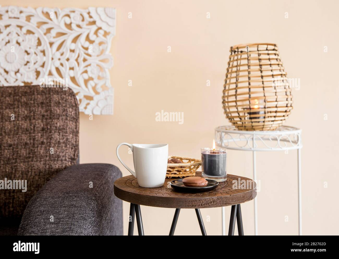 Modern Minimalist Home Living Room With Oriental Asia Style Decorative Elements Carved Wall Panel Bamboo Candle Lantern Small Wooden Side Table Stock Photo Alamy