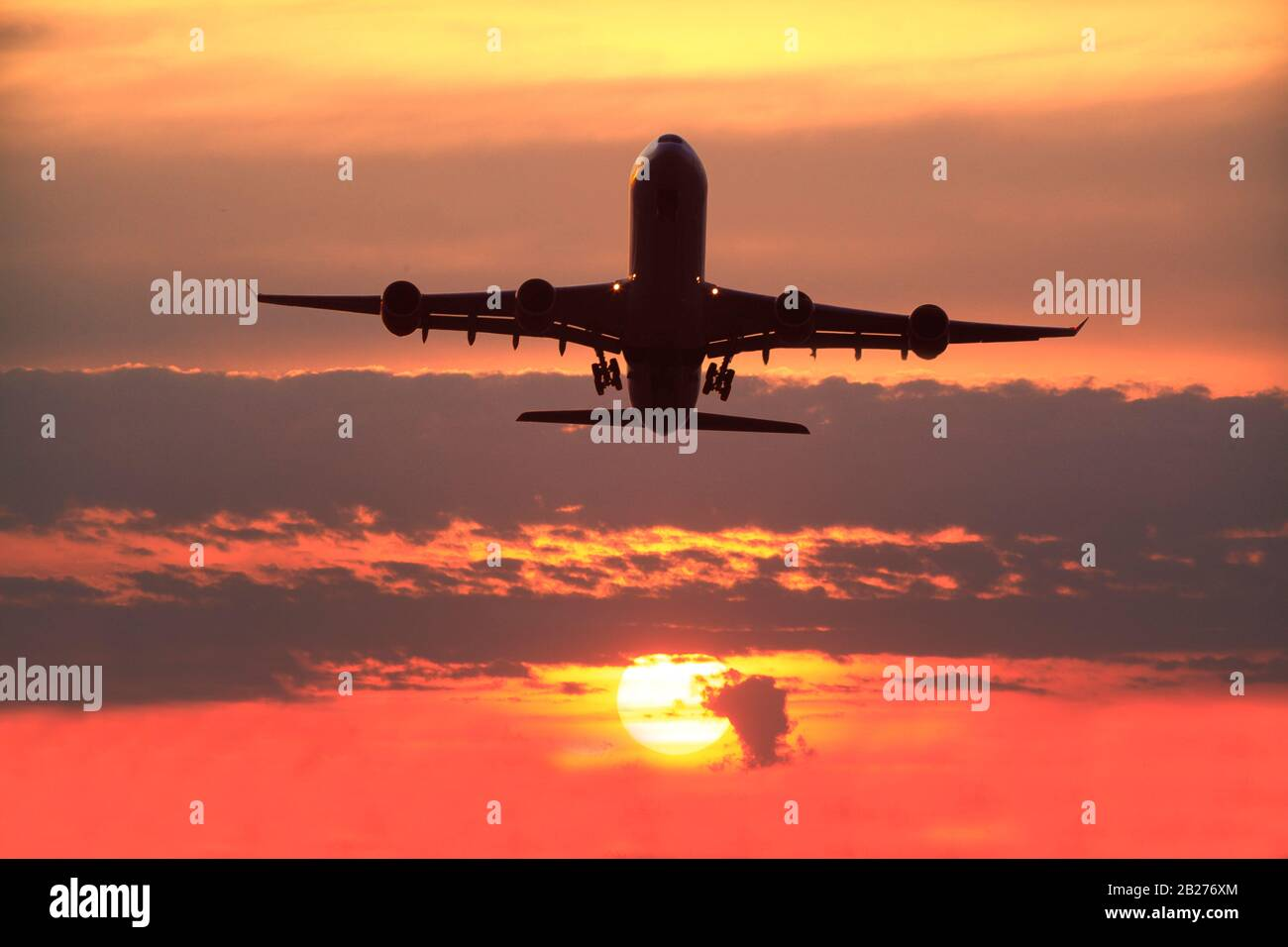 Boeing 747-400 Airliner Take off across a fabulous sunset . Stock Photo