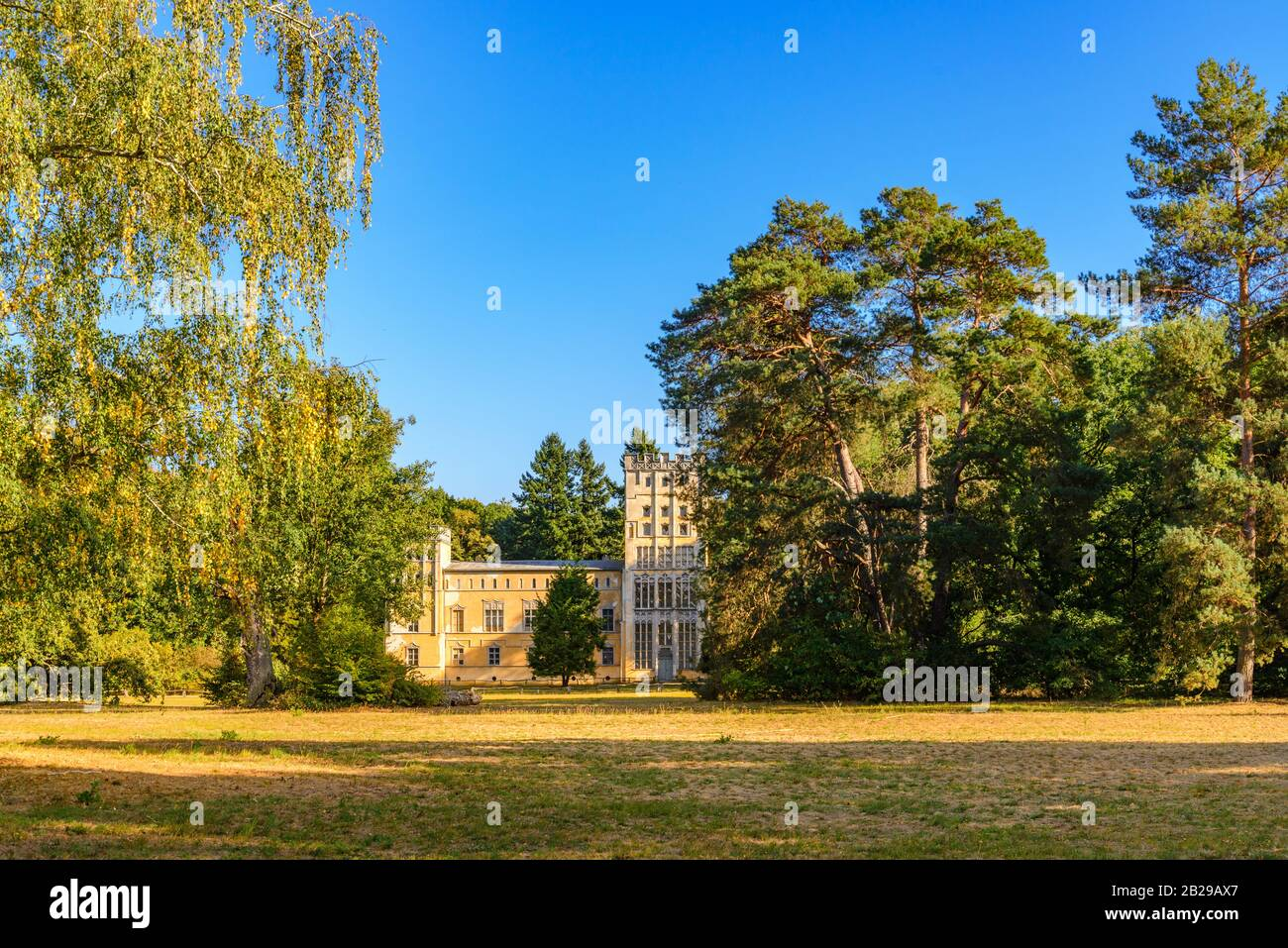 Scenery of the house, Kavaliershaus, surrounded by tree at Pfaueninsel, Peacock island, located on Wannsee lake in Berlin, Germany in Autumn season. Stock Photo