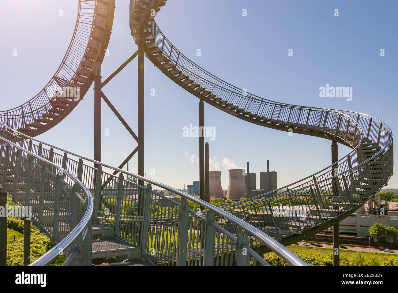 """""""Tiger and Turtle"""" or """" Magic Mountain"""" famous sculpture on top of the hill in Anger park surrounded with  lower industrial landscape and park. Stock Photo"""