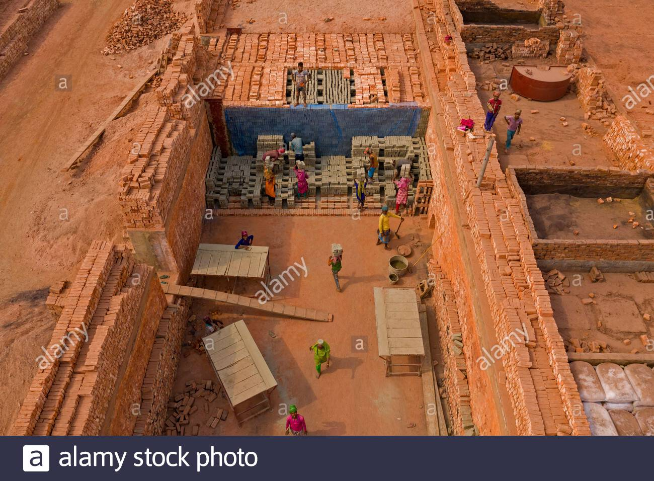 Bangladesh's brick making industry which show them piling up in thousands as manufacturing processes wreak havoc on the surrounding environment. Stock Photo