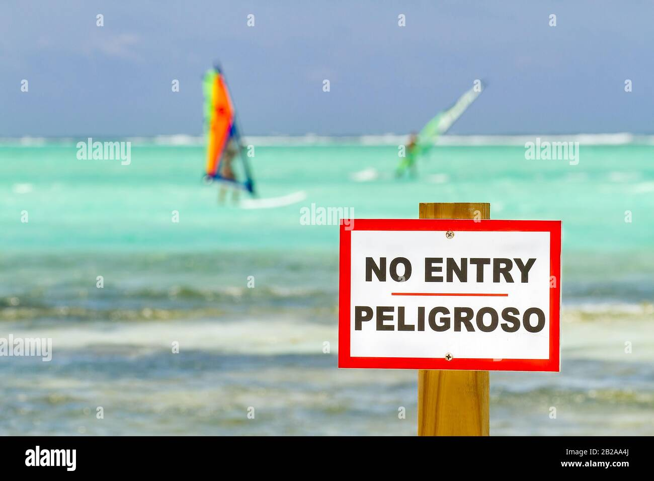 No entry sign standing in ocean with windsurfers on bonaire Stock Photo