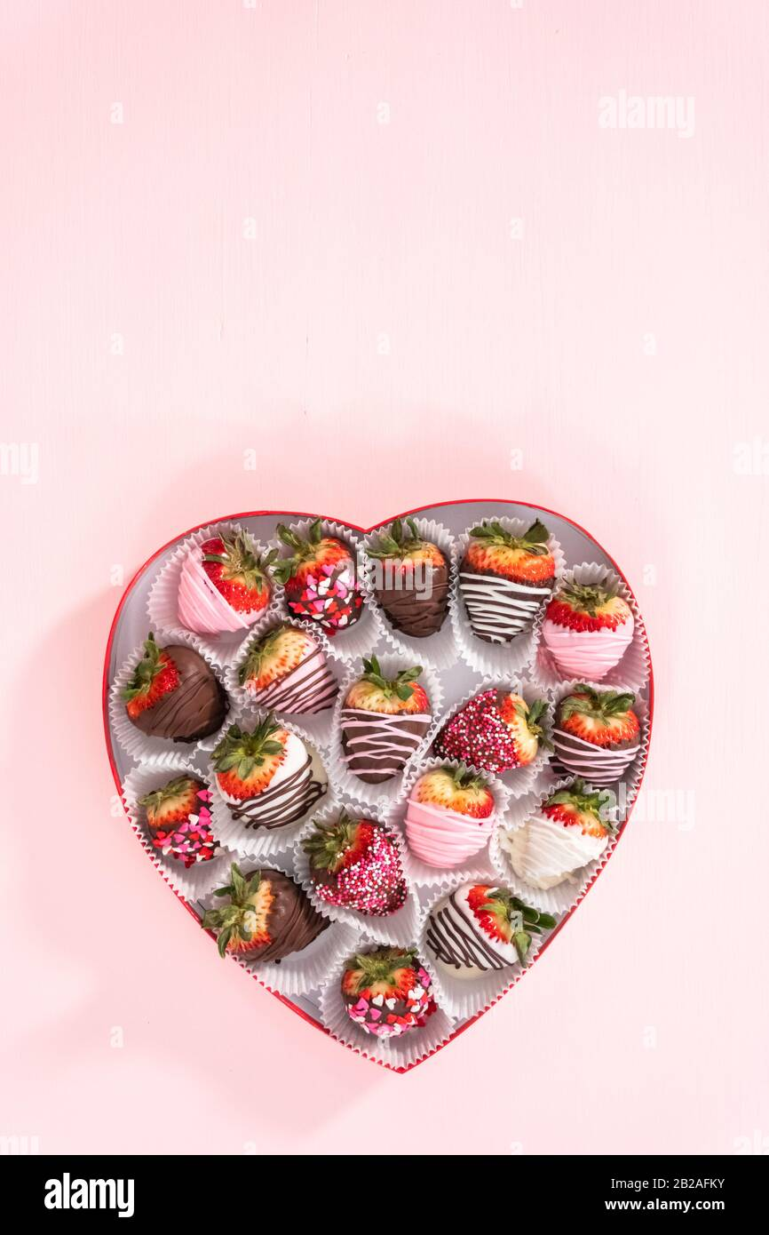 Flat Lay Variety Of Chocolate Dipped Strawberries In A Heart Shaped Box Stock Photo Alamy