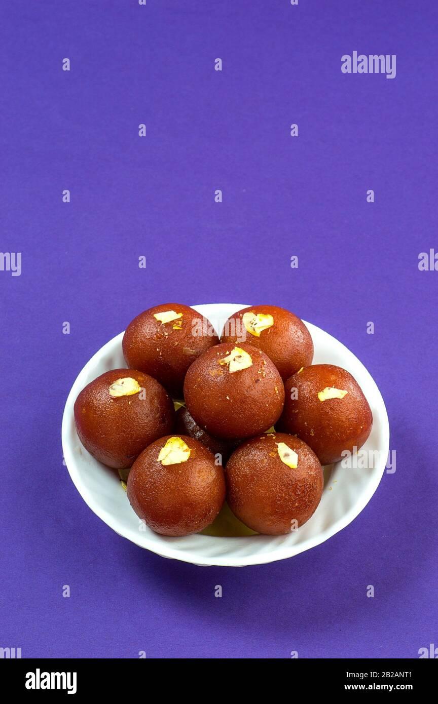Indian Dessert Gulab Jamun In White Bowl Stock Photo Alamy