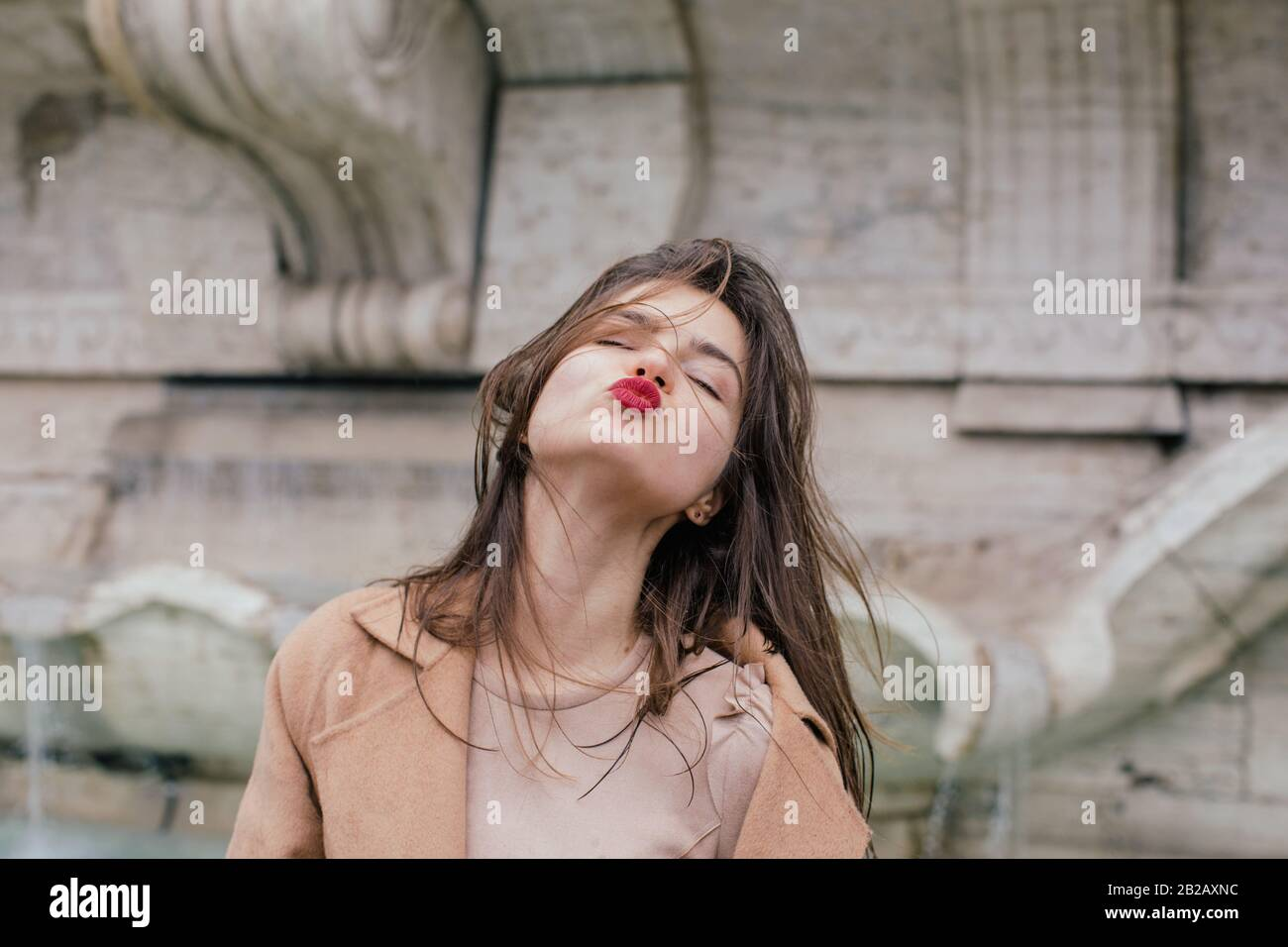 Woman puckering up and blowing a kiss, Rome, Lazio, Italy Stock Photo