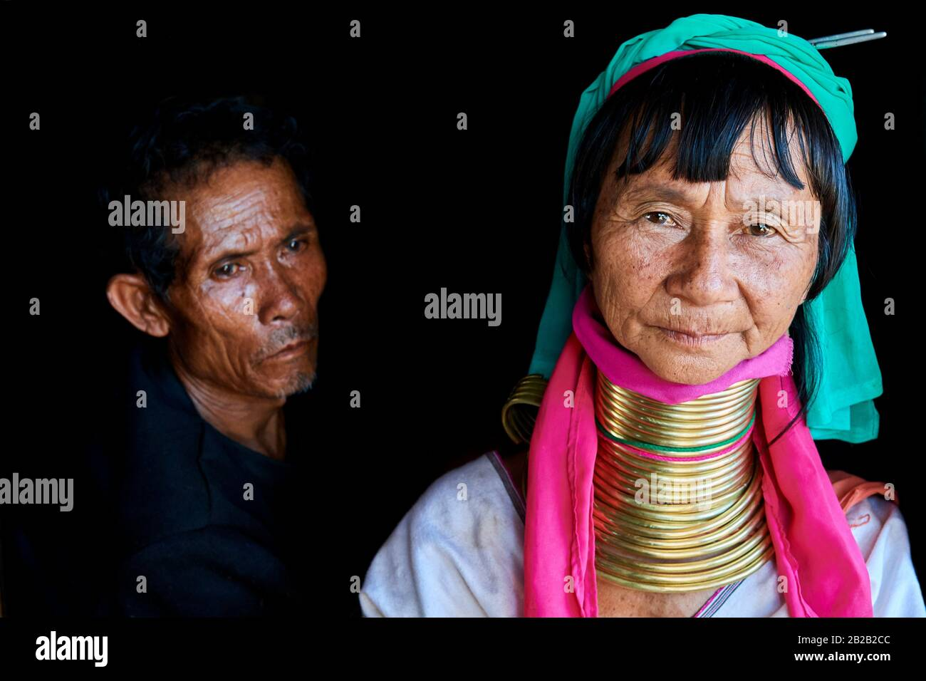 Portrait of a Kayan Lahwi woman with her husband. The Long Neck Kayan (also called Padaung in Burmese) are a sub-group of the Karen ethnic from Stock Photo
