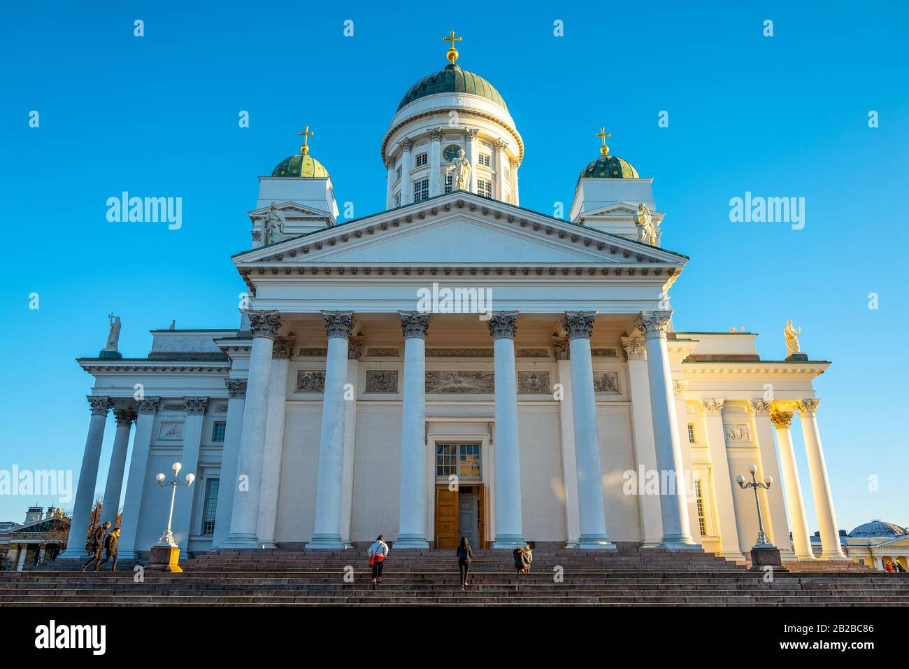 Helsinki, Finland, Visitors on the staircase of the Cathedral seen from Senate Square Stock Photo
