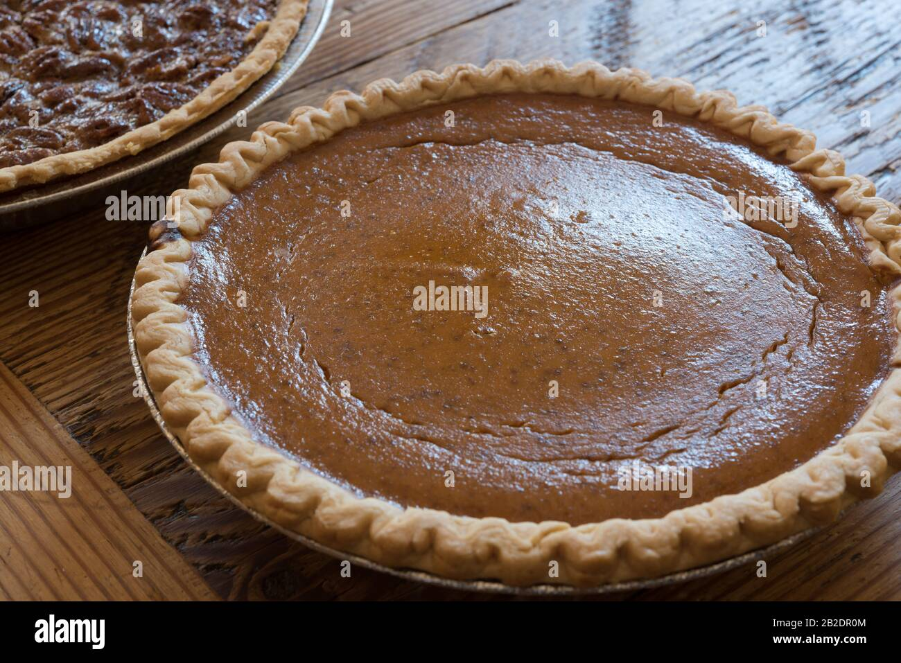 A Homemade pumpkin pie on old painted wood table Stock Photo