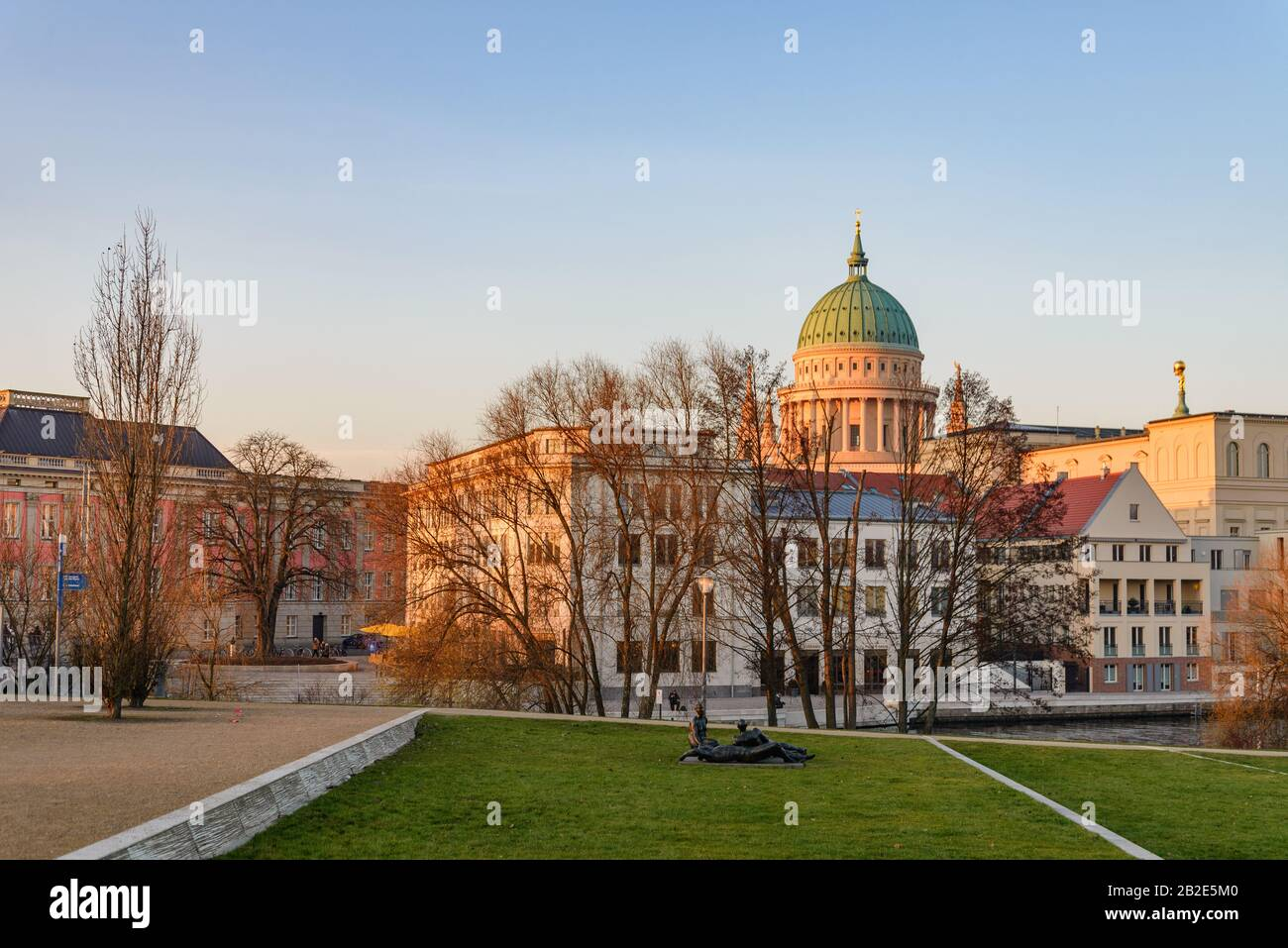 Outdoor waterside of Alte Fahrt river and background of Potsdam city centre and tower of St. Nikolaikirche,  Evangelical Church, in Potsdam, Germany. Stock Photo