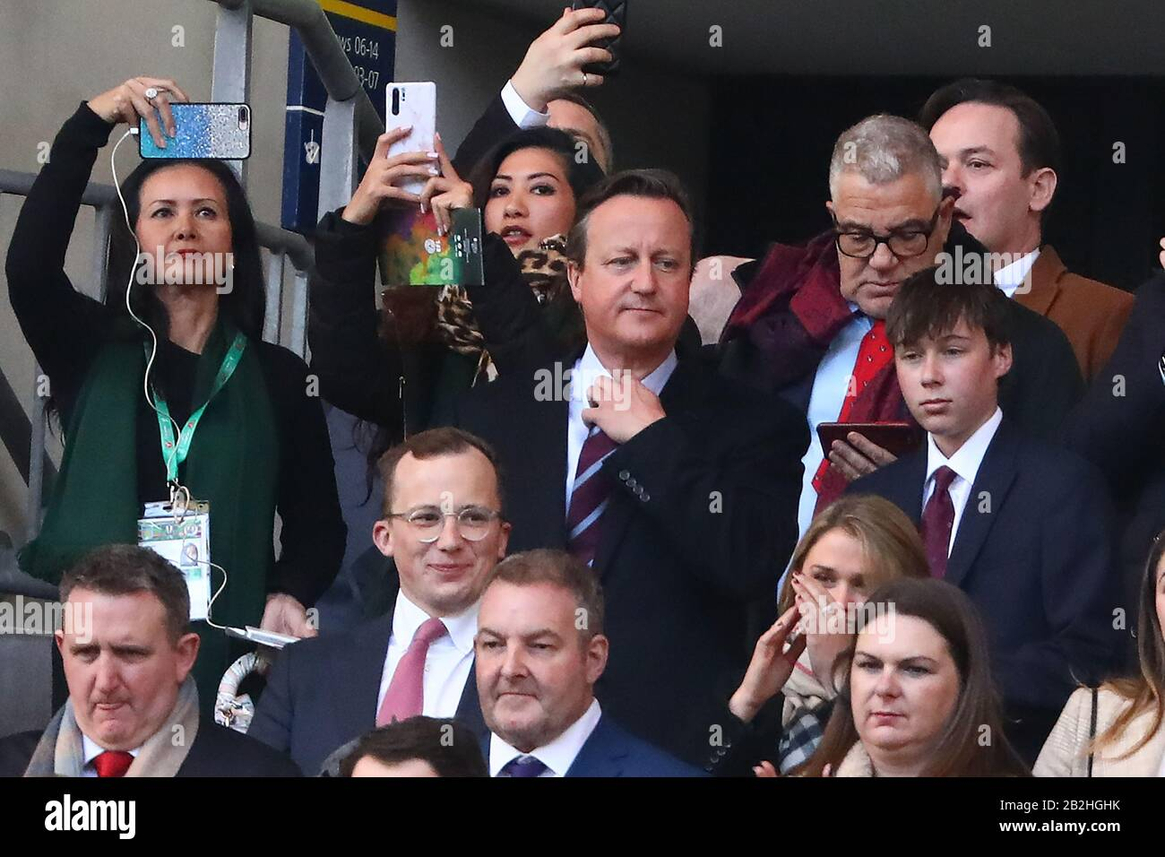 Former Prime Minister of the United Kingdom, David Cameron sings the national anthem ahead of kick off with his son, Elwin (R) - Aston Villa v Manchester City, Carabao Cup Final, Wembley Stadium, London, UK - 1st March 2020  Editorial Use Only - DataCo restrictions apply Stock Photo