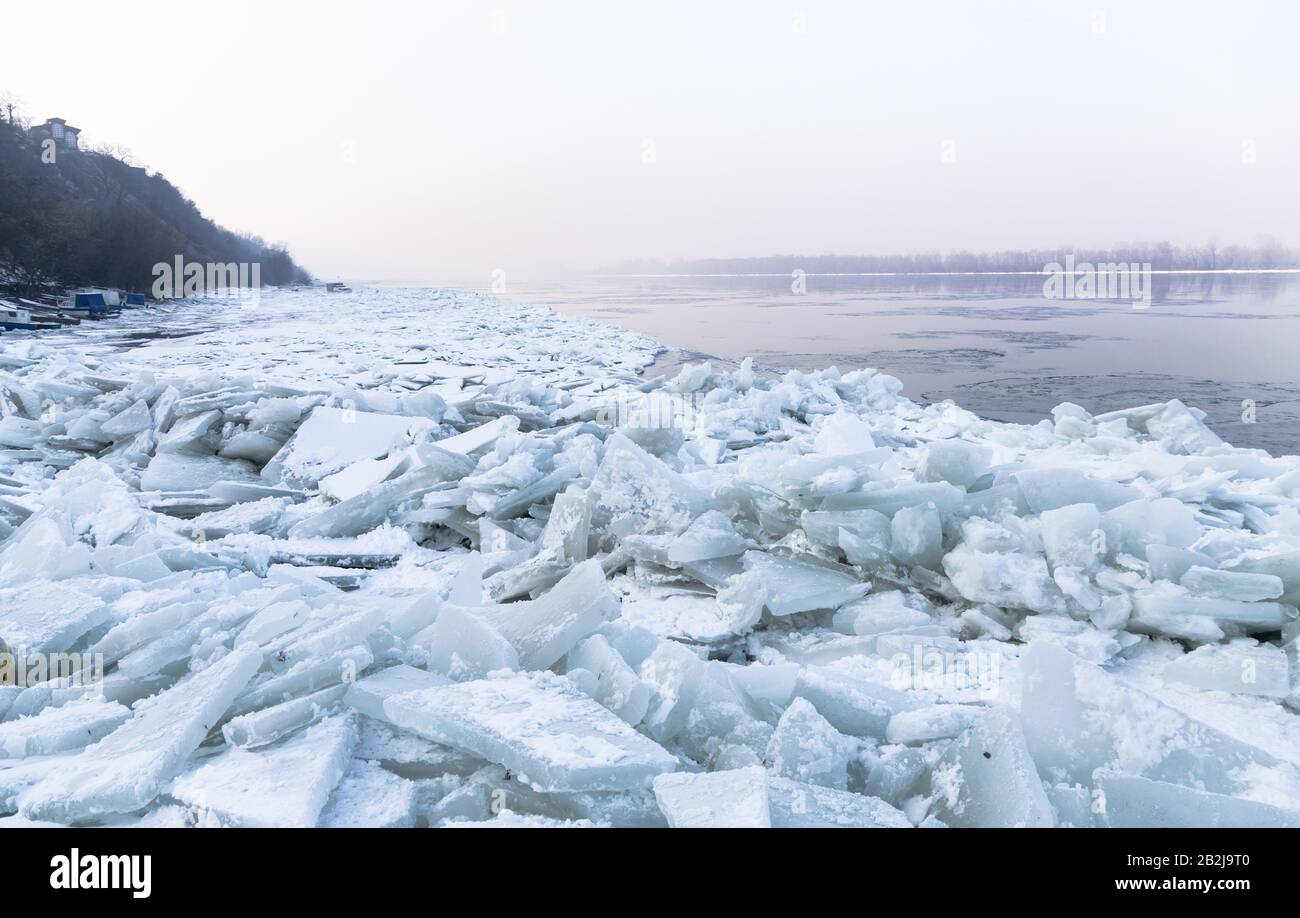 Lots of ice cubes on the Danube river with the trapped fishing boats, Belgrade Serbia Stock Photo