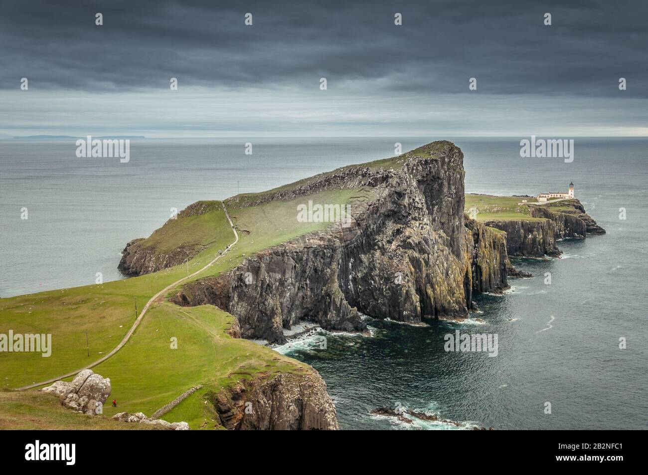Neist Point lighthouse from Neist Cliff viewpoint with a dramatic colorful sky Stock Photo