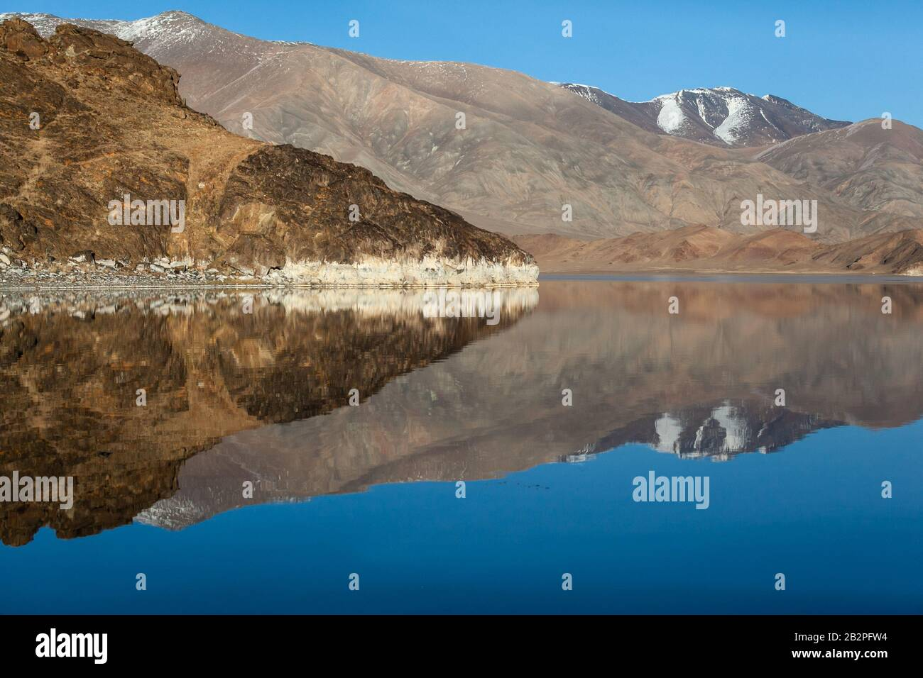 Mirror reflection in calm lake. morning light. Western Mongolia Stock Photo