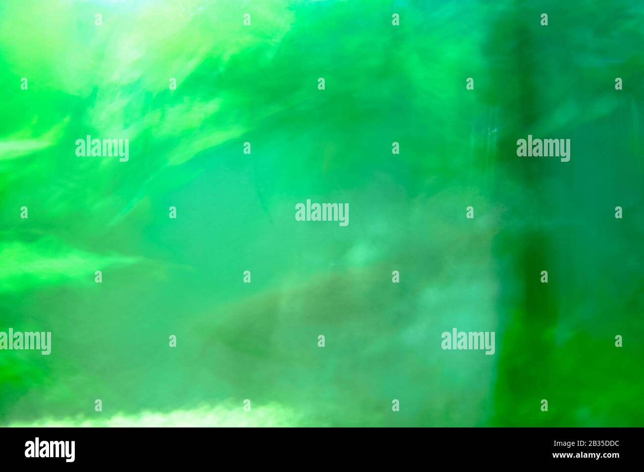 Abstract green reflection glass with water. Blurry greenish reflection in a small tank Stock Photo