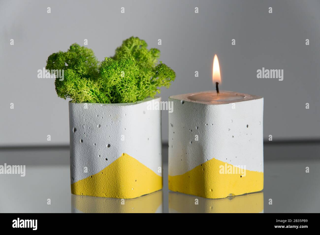 Candles And Moss In White And Yellow Concrete Candle Holders Stock Photo Alamy