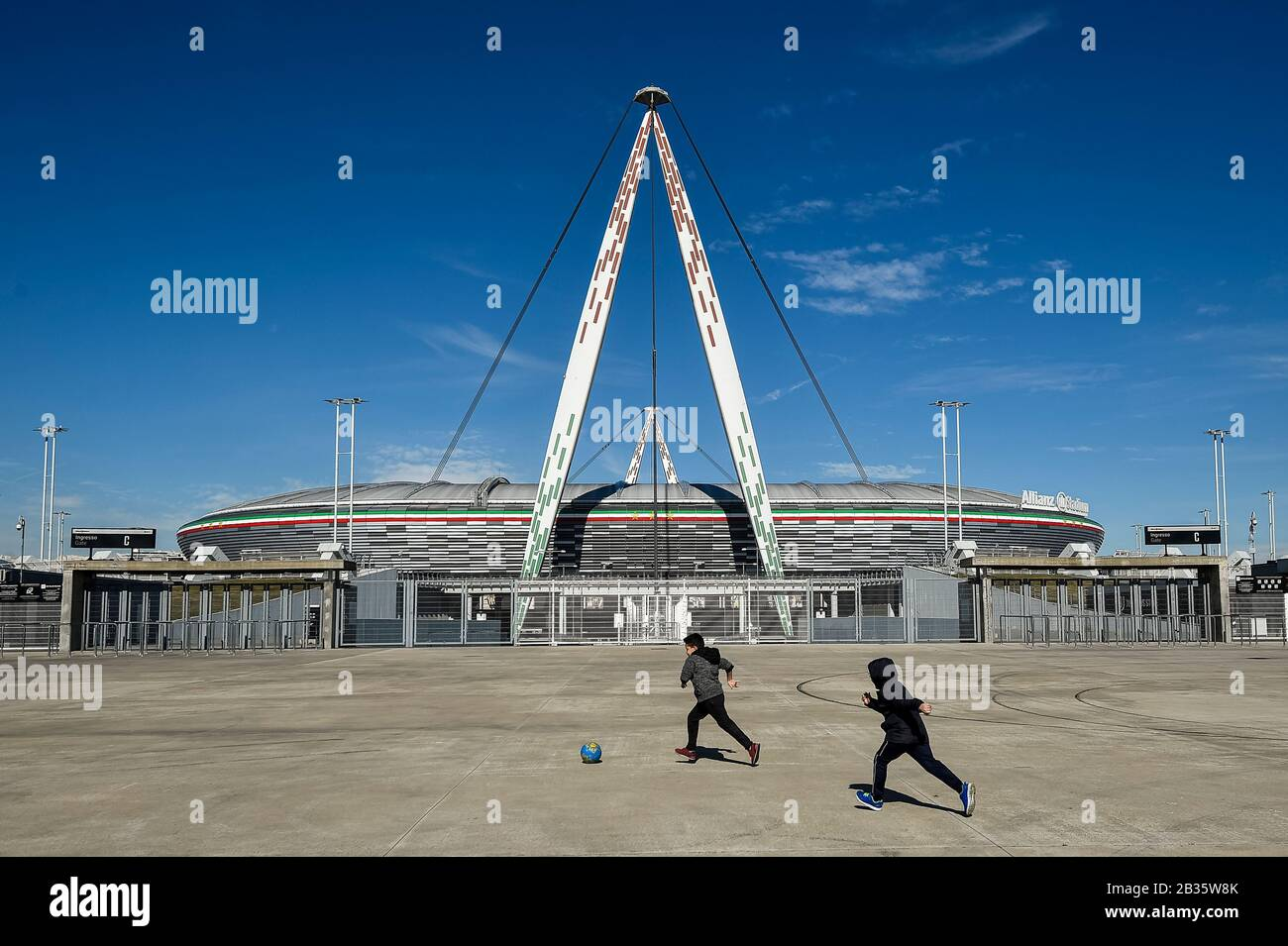 Turin Italy March 04 2020 Two Childs Play With A Ball Outside Desert Allianz Stadium Also
