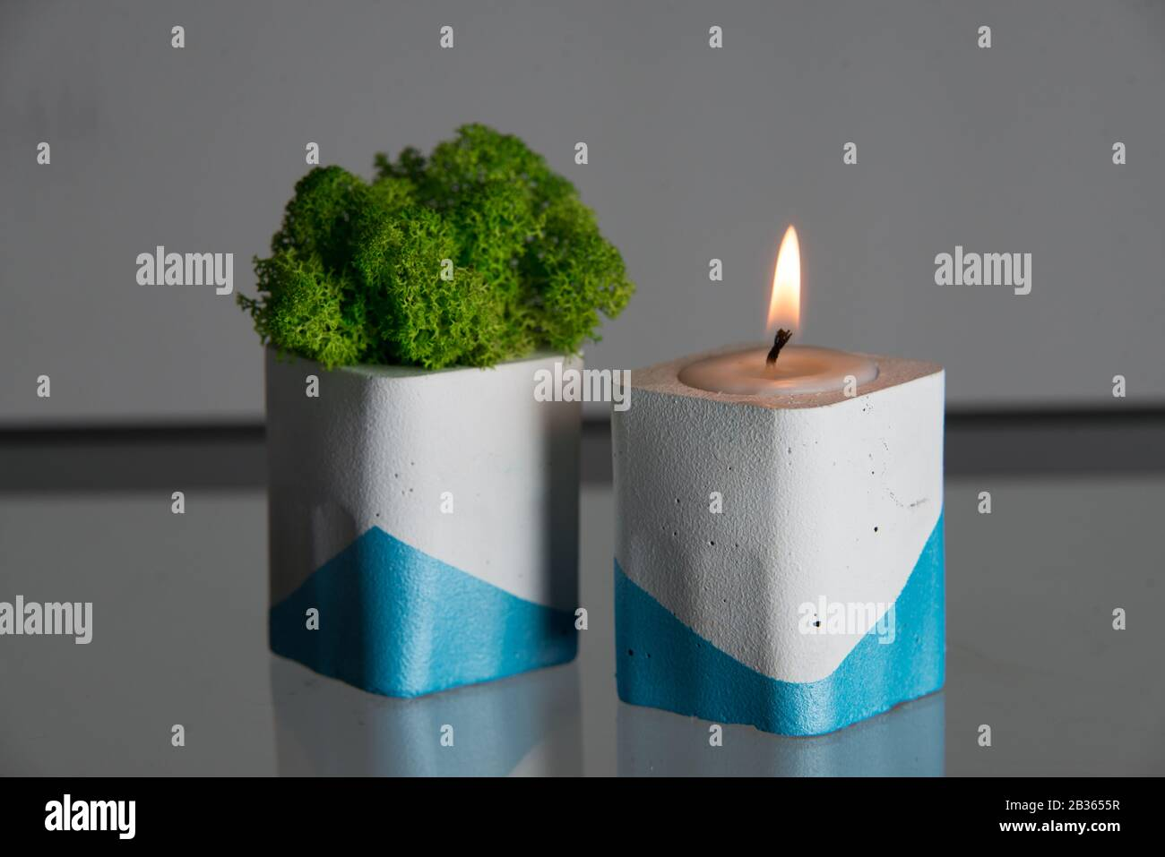 Candle And Moss In White And Blue Concrete Candle Holders Stock Photo Alamy