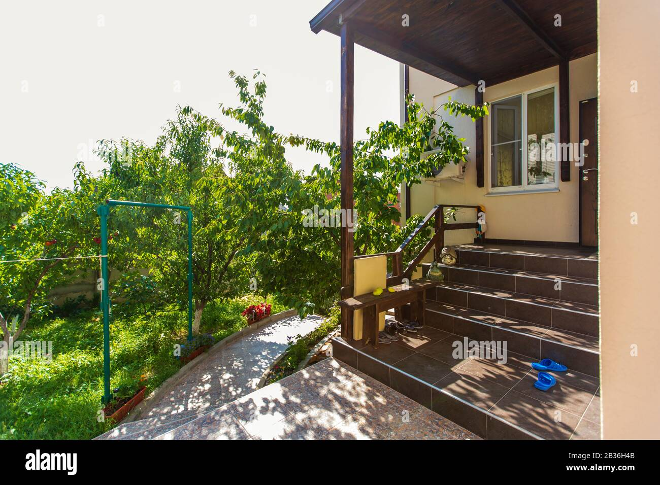 Porch Steps And Entrance To The Cottage In The Back Yard Of The House Canopy Over The Entrance Shoes On The Porch Backyard With Trees Sunny Day Stock Photo Alamy