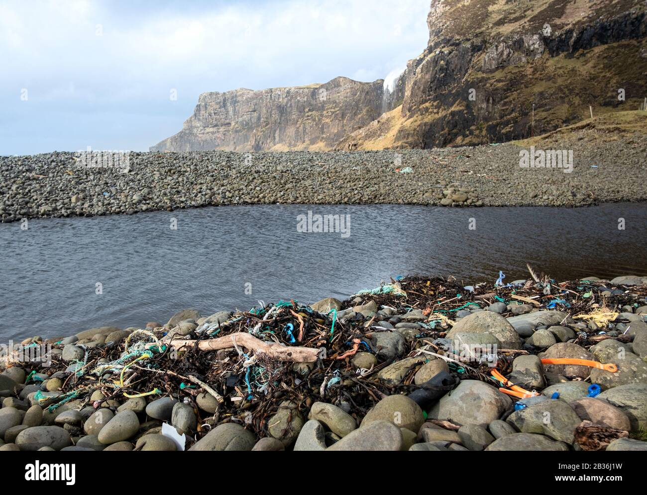 Plastic and nylon rope pollution on the beach at remote Talisker Bay, Skye, Inner Hebrides Stock Photo