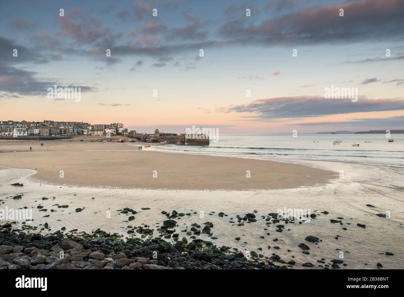 Sunset at Harbour Beach, St Ives, Cornwall at low tide. Stock Photo