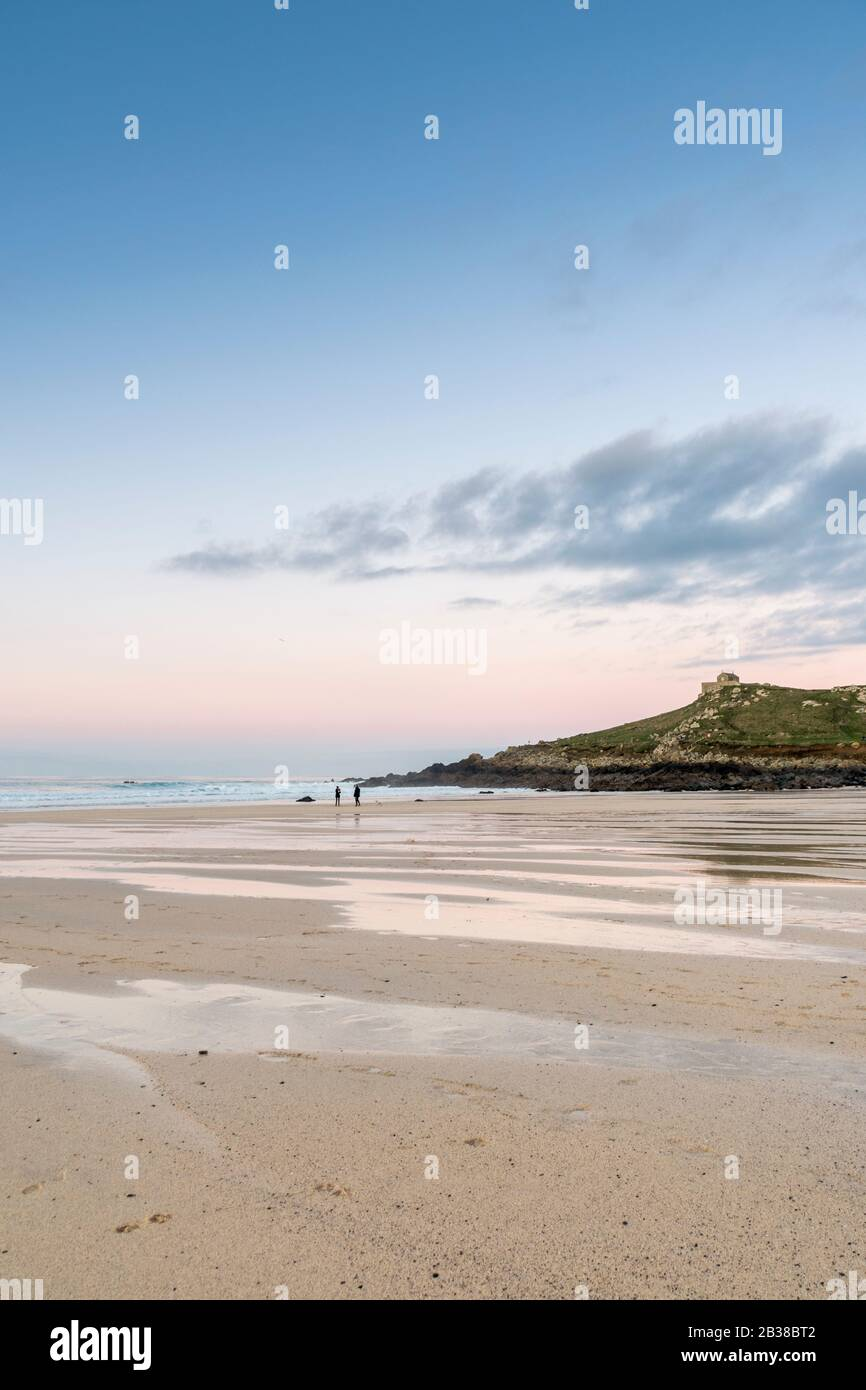 Sunset from Porthmeor Beach, St Ives, looking towards the Island Stock Photo