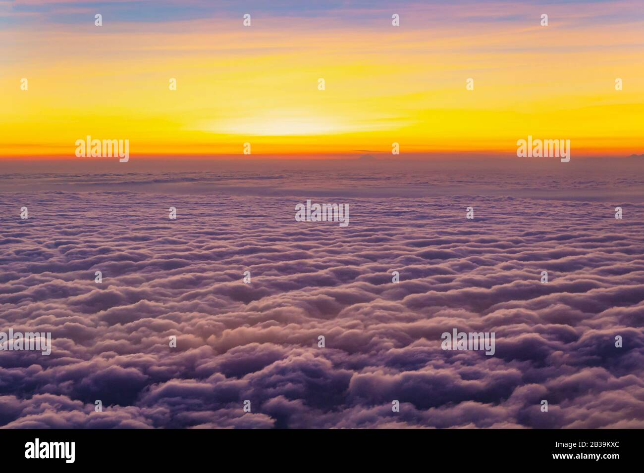 Beautiful And Colorful Sunset Above Purple Color Clouds Looking Through An Airplane Window Stock Photo Alamy