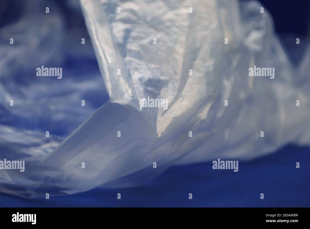Close up view of transparent polyethylene plastic bag from on a blue background Stock Photo