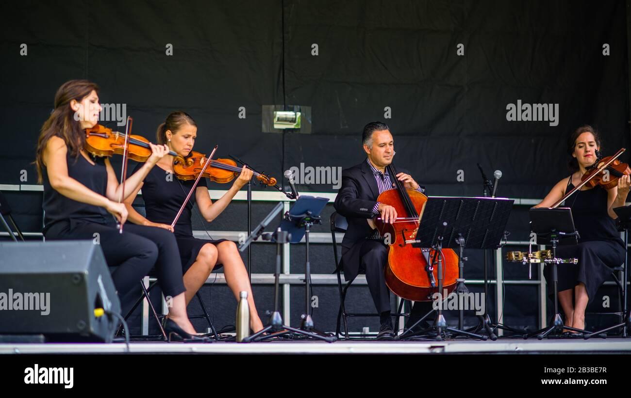 Saint Hubert, Canada - July 28 2019: Quartet band playing in the Parc de la Cité in Saint Hubert Stock Photo