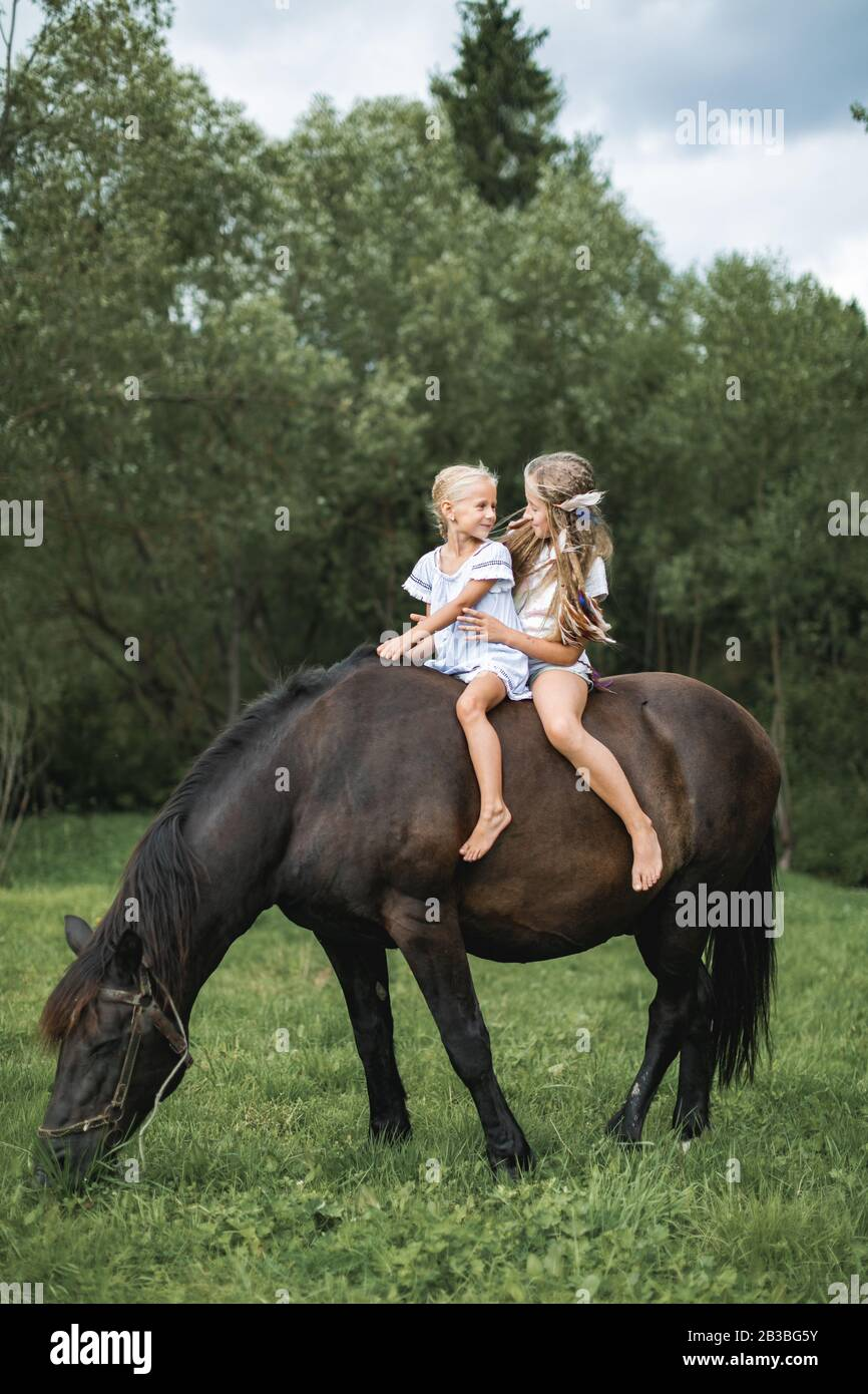 Kids Riding Horse In The Mountains Family Vacation On Horse Ranch Children Ride Horse Child And Pet Little Girls Having Fun While Walking Outdoors Stock Photo Alamy
