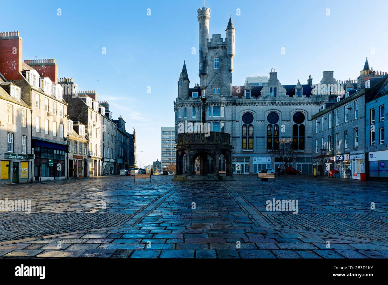 Early Morning photograph of empty Mercat Cross square, Castlegate, Aberdeen, Scotland, the Salvation Army Church in the background Stock Photo