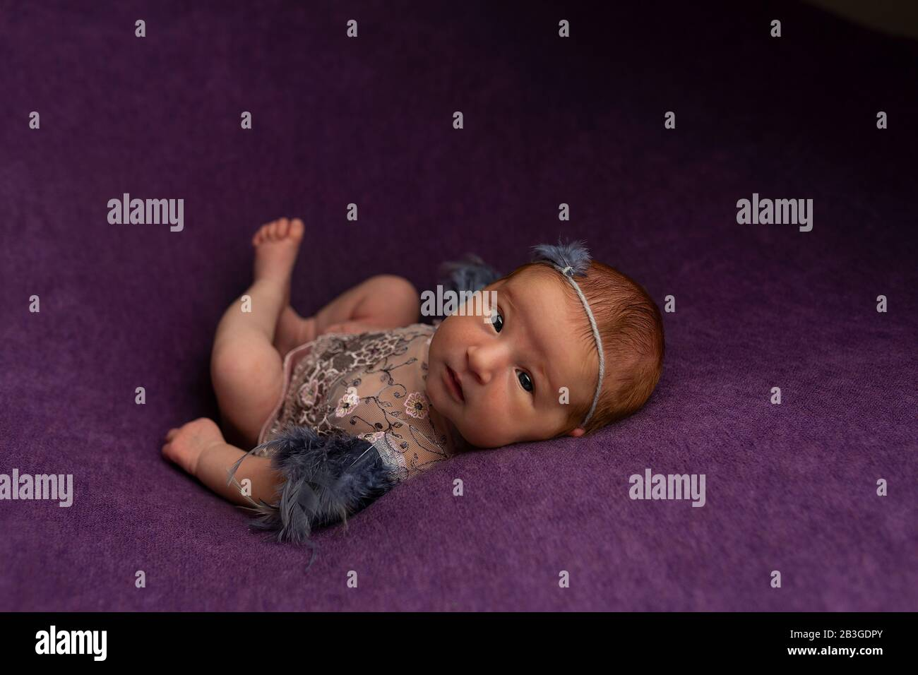 Pretty Newborn Baby Girl In Pink Dress On Textile Background With A Headband Newborn Props And Photo Ideas For The First Photo Session Stock Photo Alamy
