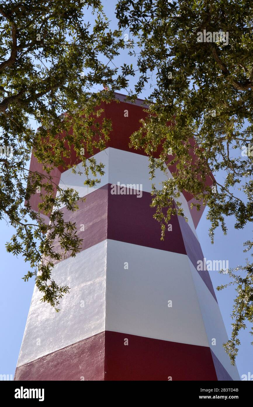 Lighthouse seen among the trees in Harbor Town, Hilton Head Island. Stock Photo