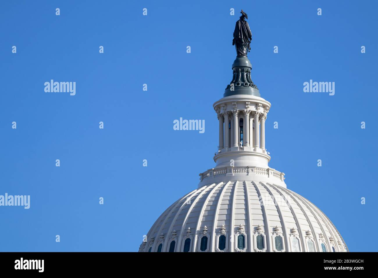 Closeup of US Capital Building Dome with the back of the bronze Statue of Freedom seen on clear day. Stock Photo